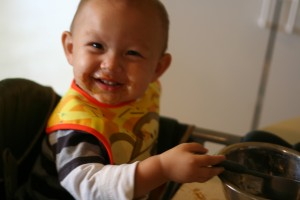 17 month-old Wyatt with messy cookie dough face